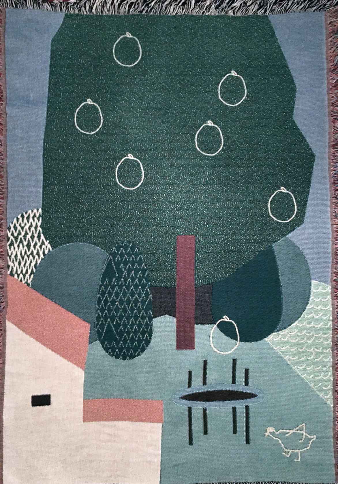 Woven plaid with garden, tree and house